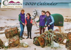 Calendar front cover, 2 children, 2 adults and a pony on a beach